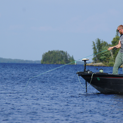 fly fishing on rainy lake for bass