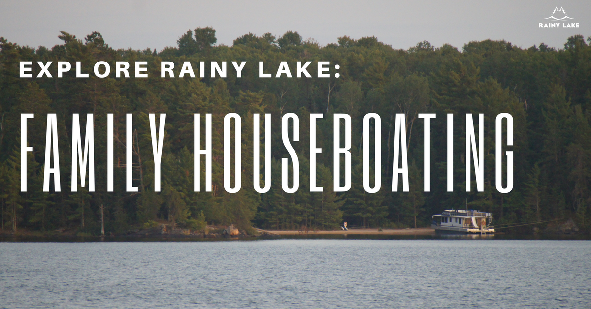 family houseboating on rainy lake